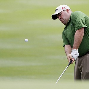 Kevin Stadler hits to the eighth green during the first round of the Texas Open.