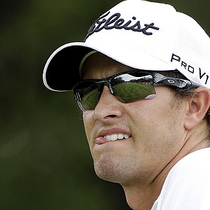 Adam Scott watches his tee shot on the ninth hole during the first round of the Texas Open.