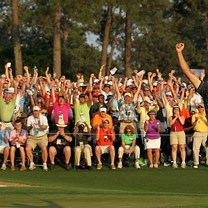 Charl Schwartzel celebrates his two-stroke victory on the 18th green during the final round of the 2011 Masters.