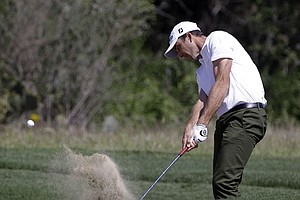 Geoff Ogilvy hits from a fairway bunker on the second hole during the second round of the Texas Open.