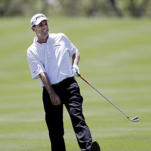 Kevin Sutherland reacts to his approach shot on the 18th hole during the second round of the Texas Open.