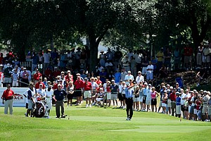 A large crowd watches as actor Craig T. Nelson hits his tee shot at No. 18.