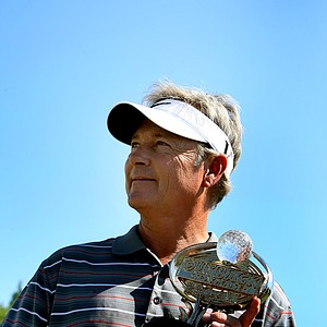 John Cook holds the Outback Steakhouse Pro-Am trophy after defeating Jay Don Blake in a playoff.
