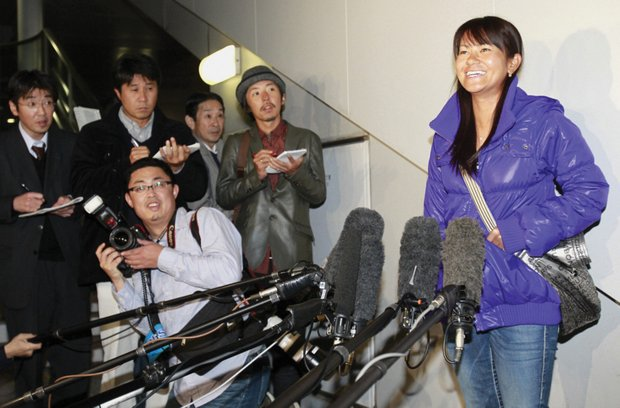 Miyazato is greeted by Japanese media wherever she goes, such as here, at an airport near Tokyo.