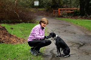 Nike's Cindy Davis and her puppy before a long run in Oregon.