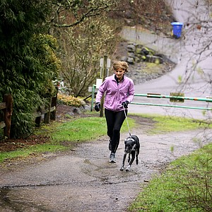 Nike's Cindy Davis and her puppy on a long run in Oregon.