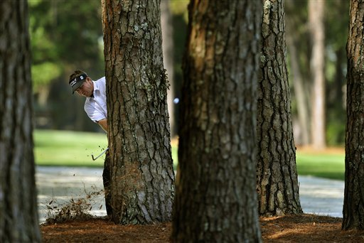 Jason Bond hits from the pine trees along the 14th fairway during the third round of The Heritage.