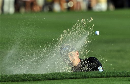 Luke Donald hits out of the bunker during a playoff with Brandt Snedeker on the 18th green during the The Heritage.
