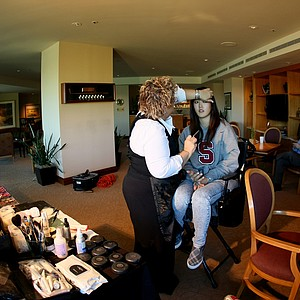 11/24/09--Lynda Shaeps works on the hair and make up of LPGA player Michelle Wie at Bighorn Country Club in Palm Desert, Calif., prior to her photoshoot.