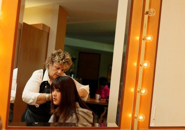 11/24/09--Lynda Shaeps works on the hair of LPGA player Michelle Wie at Bighorn Country Club in Palm Desert, Calif., prior to her photoshoot.