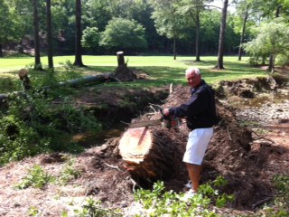 Workers clean up debris at Shoal Creek.