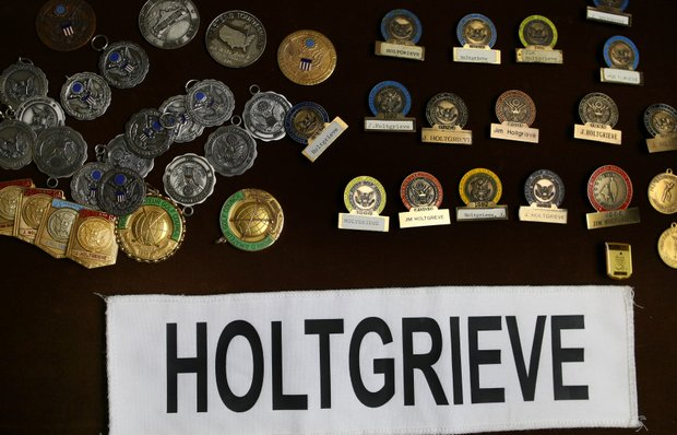 Jim Holtgrieve's collection of player badges from USGA events. Holtgrieve turned professional in 1998 playing for seven seasons.