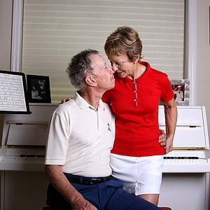 Dave and Nicole Ragaini share a moment in their music room while being photographed for Golfweek. They have been married 35 years.