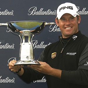 Lee Westwood from England poses with a winner trophy during the Ballantine's Championship at Blackstone Golf Club in Icheon, east of Seoul, South Korea, Sunday, May 1, 2011. Westwood won the 2011 Ballantine's Championship on Sunday to make it two tournament victories in the space of a week