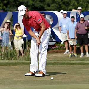 Webb Simpson putts on the 17th green during the final round of the Zurich Classic.