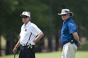 Steve Spurrier, left, at the Chick-fil-A Bowl Challenge in Greensboro, Ga.