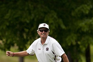South Carolina coach Steve Spurrier reacts to a missed putt at the Chick-fil-A Bowl Challenge in Greensboro, Ga.