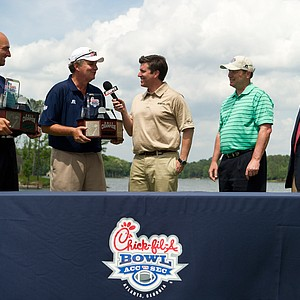 Georgia Tech's Jon Barry (left) and Paul Johnson after winning the 2011 Chick-fil-A Bowl Challenge at Reynolds Plantation.