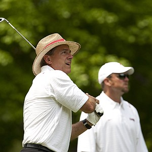 Alabama coach Nick Saban watches his tee ball at the Chick-fil-A Bowl Challenge in Greensboro, Ga.