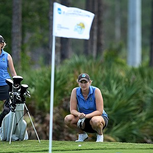 Jessica Alexander of Coastal Carolina looks over her shot at No. 17 during the Women's NCAA East Regionals.