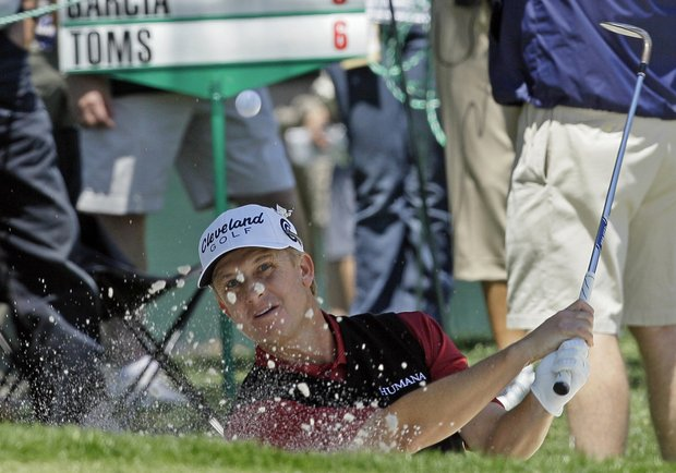 David Toms hits from a trap on the 16th hole during the first round of the Wells Fargo Championship golf tournament at Quail Hollow Club in Charlotte, N.C., Thursday, May 5, 2011.
