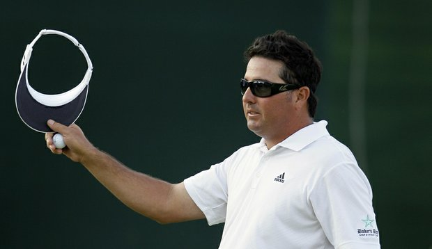 Pat Perez tips his visor on the 18th green following his second round at the Wells Fargo Championship.