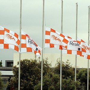 Flags fly at half-mast behind the driving range, following news of the death of Seve Ballesteros, during the third round of the Spanish Open.