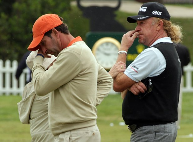 Jose Maria Olazabal and Miguel Angel Jimenez of Spain after the minute silence held in memory of Seve Ballesteros during the third round of the Spanish Open.