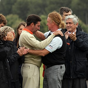 Jose Maria Olazabal and Miguel Angel Jimenez after the minute silence held in memory of Seve Ballesteros during the third round of the Spanish Open.