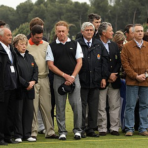 Jose Maria Olazabal, Miguel Angel Jimenez  and various members of the European Tour during the minute silence held in memory of Seve Ballesteros during the third round of the Spanish Open.