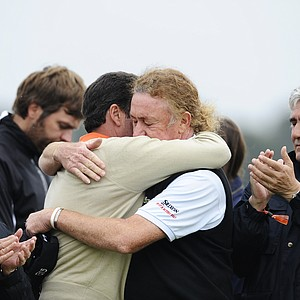 Spanish golfers Jose Maria Olazabal, left, and Miguel Angel Jimenez after the minute silence held in memory of Seve Ballesteros during the third round of the Spanish Open.
