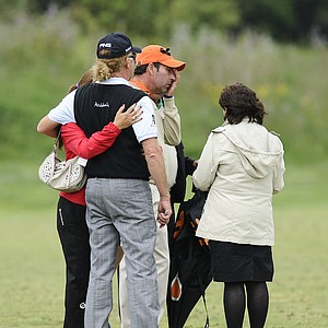 Spanish golfers Jose Maria Olazabal, center, and Miguel Angel Jimenez, left, cry after observing a minute of silence in memory of Seve Ballesteros at the Spanish Open.