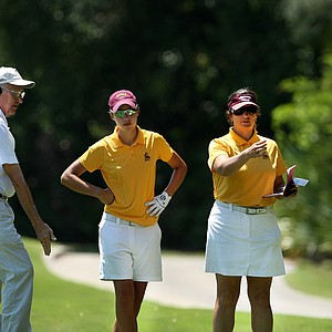 Arizona State's Carlota Ciganda, center, gets a ruling from NCAA rules official Ted Burfeind, left, at No. 18 during the Women's NCAA East Regionals. At right is Arizona State head coach, Melissa Luellen.