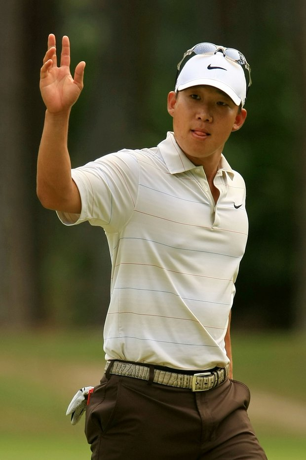 Anthony Kim waves to the gallery after making birdie on the 10th hole during the third round of THE PLAYERS Championship on THE PLAYERS Stadium Course at TPC Sawgrass on May 10, 2008 in Ponte Vedra Beach, Florida.