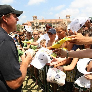 Phil Mickelson signs autographs for fans during the second day of practice for the THE PLAYERS Championship on THE PLAYERS Stadium Course at TPC Sawgrass on May 6, 2008 in Ponte Vedra Beach, Florida.