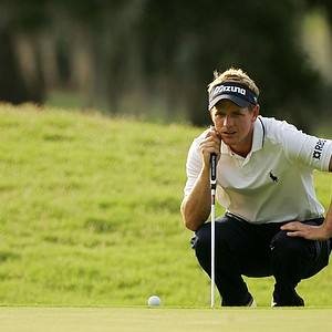 Luke Donald of England lines up his putt on the seventh hole during the first round of the THE PLAYERS Championship on THE PLAYERS Stadium Course at TPC Sawgrass on May 8, 2008 in Ponte Vedra Beach, Florida.
