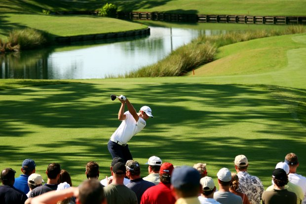 Dustin Johnson plays his tee shot on the 16th hole while a gallery of fans looks on during the second round of THE PLAYERS Championship on THE PLAYERS Stadium Course at TPC Sawgrass on May 8, 2009 in Ponte Vedra Beach, Florida.
