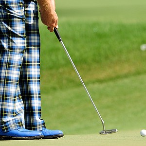 A detailed shot of Ian Poulter's pants and shoes is seen while he putts on the 16th hole during the second round of THE PLAYERS Championship held at THE PLAYERS Stadium course at TPC Sawgrass on May 7, 2010 in Ponte Vedra Beach, Florida.