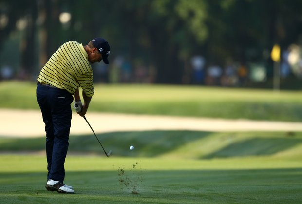 Davis Love III plays his second shot on the 11th hole during the second round of THE PLAYERS Championship held at THE PLAYERS Stadium course at TPC Sawgrass on May 7, 2010 in Ponte Vedra Beach, Florida.