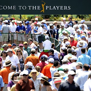 Fans walk to the first tee box during the second round of THE PLAYERS Championship on THE PLAYERS Stadium Course at TPC Sawgrass on May 7, 2010 in Ponte Vedra Beach, Florida.