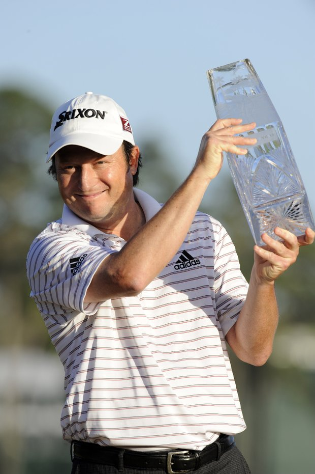 Tim Clark holds the winner's trophy after the final round of THE PLAYERS Championship on THE PLAYERS Stadium Course at TPC Sawgrass on May 9, 2010 in Ponte Vedra Beach, Florida.
