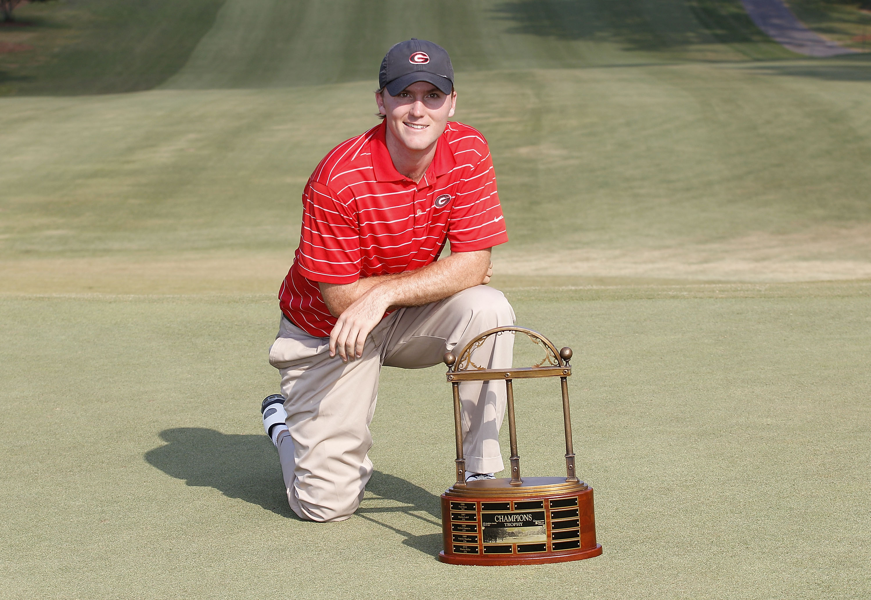 Russell Henley holds the trophy after winning the Stadion Classic at UGA held at the University of Georgia Golf Course on May 8, 2011 in Athens, Georgia. Henley is an amateur and a student at the University of Georgia.