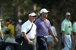 Tiger Woods and Sean Foley walk down the fairway at No. 9 during a practice round on Tuesday at The Players Championship at TPC Sawgrass.