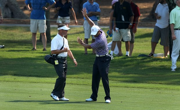 Tiger Woods with Sean Foley on a Tuesday practice round during The Players Championship at TPC Sawgrass.