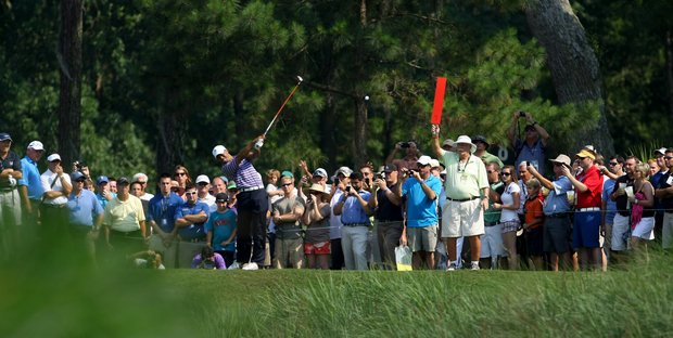 Tiger Woods hits his tee shot at No. 9 during a practice round at The Players Championship at TPC Sawgrass.