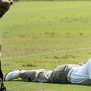 Charley Hoffman lies down on the practice range looking at a camera on Tuesday during The Players Championship at TPC Sawgrass.