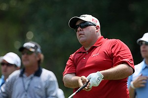 Kevin Stadler hits his tee shot at No. 9 during a practice round at The Players Championship at TPC Sawgrass.