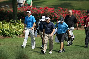 South African players Charl Schwartzel, left, and Louis Oosthuizen walk to the 13th green during Tuesday's practice round at The Players Championship at TPC Sawgrass.