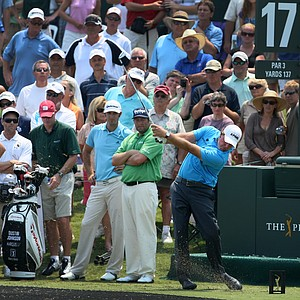 Phil Mickelson, right, hits his tee shot at No. 17, a 137 yard, par-3, during a Tuesday practice round at The Players Championship at TPC Sawgrass. At left are Steve Marino and Dustin Johnson.