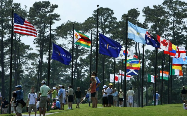 Fans watch as players practice on the range during The Players Championship at TPC Sawgrass.-